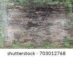 green peeling wood texture | Shutterstock . vector #703012768