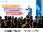 audience listens to the... | Shutterstock . vector #703013092