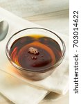 raw organic dark agave syrup in ... | Shutterstock . vector #703014622