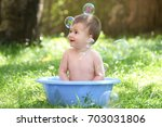 outdoor baby bathing. happy... | Shutterstock . vector #703031806