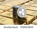 ripple coins laying on stacked... | Shutterstock . vector #703031845