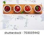 bowls of various tomato sauces... | Shutterstock . vector #703035442