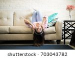 woman enjoying a relaxing day... | Shutterstock . vector #703043782