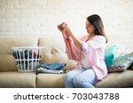 beautiful young latin woman... | Shutterstock . vector #703043788