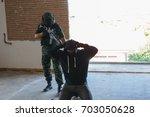 soldier is capturing terrorist. | Shutterstock . vector #703050628