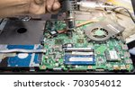 computer notebook repair ... | Shutterstock . vector #703054012