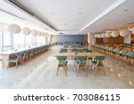 Stock photo interior of modern cafeteria for staffs in company 703086115