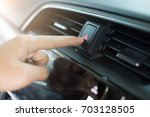 the hand is pressing the... | Shutterstock . vector #703128505
