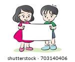 boy and girl holding blank... | Shutterstock .eps vector #703140406