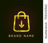 shopping bag golden metallic... | Shutterstock .eps vector #703143562