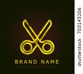 scissors golden metallic logo