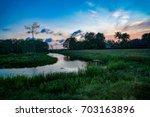 brilliant sunset in the... | Shutterstock . vector #703163896
