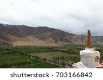 white stupa pagoda  with golden ... | Shutterstock . vector #703166842