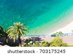 crystal clear water in nice ... | Shutterstock . vector #703175245