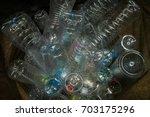bottle in black garbage bag  ... | Shutterstock . vector #703175296