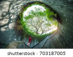 a woman at fort canning park ... | Shutterstock . vector #703187005