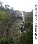 waterfall mountain  | Shutterstock . vector #703188076