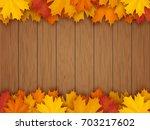 border from fallen maple leaves ...   Shutterstock .eps vector #703217602