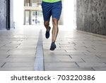 young man running on the street ... | Shutterstock . vector #703220386