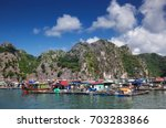 traditional vietnamese boats... | Shutterstock . vector #703283866