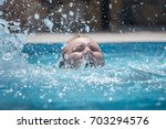 person drowns in the pool with... | Shutterstock . vector #703294576