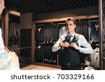 client is elegant guy trying on ... | Shutterstock . vector #703329166