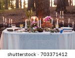 puffy wedding cake with flowers   Shutterstock . vector #703371412