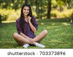 attractive full body shot of... | Shutterstock . vector #703373896