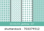 set of 4 geometric patterns.... | Shutterstock .eps vector #703379512