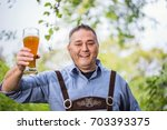 mature happy man in typical... | Shutterstock . vector #703393375