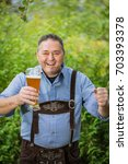 mature happy man in typical... | Shutterstock . vector #703393378