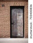 A Striking Metal Door With...