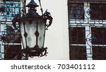 Detail with a vintage lamp and windows with metal grids in old town of Bratislava, Slovakia - stock photo