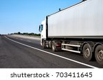 truck on road with blank... | Shutterstock . vector #703411645