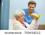 senior woman working out with...   Shutterstock . vector #703418212