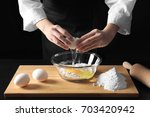 young female chef cooking on... | Shutterstock . vector #703420942