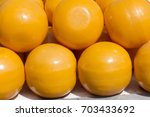 close up pile of yellow cheese... | Shutterstock . vector #703433692