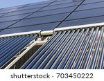 solar thermal flat panels with... | Shutterstock . vector #703450222
