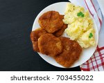 soy schnitzel and mashed... | Shutterstock . vector #703455022