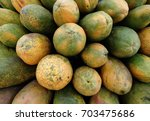 group of papayas for sale | Shutterstock . vector #703475686