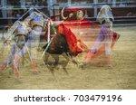 bullfighter in a bullring.... | Shutterstock . vector #703479196