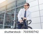 senior business man with a... | Shutterstock . vector #703500742