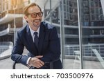 senior business man with a... | Shutterstock . vector #703500976