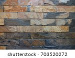 brown granite background  red... | Shutterstock . vector #703520272