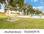 park and playground in suburban ... | Shutterstock . vector #703540975