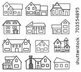 set of hand drawn houses on a... | Shutterstock .eps vector #703554895