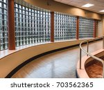 abstract curve glass window of... | Shutterstock . vector #703562365