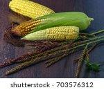 still life of cobs of corn on a ... | Shutterstock . vector #703576312