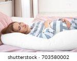 beautiful pregnant woman...   Shutterstock . vector #703580002
