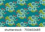 seamless folk raster pattern in ... | Shutterstock . vector #703602685